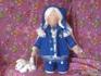 Кукла в синем пальто